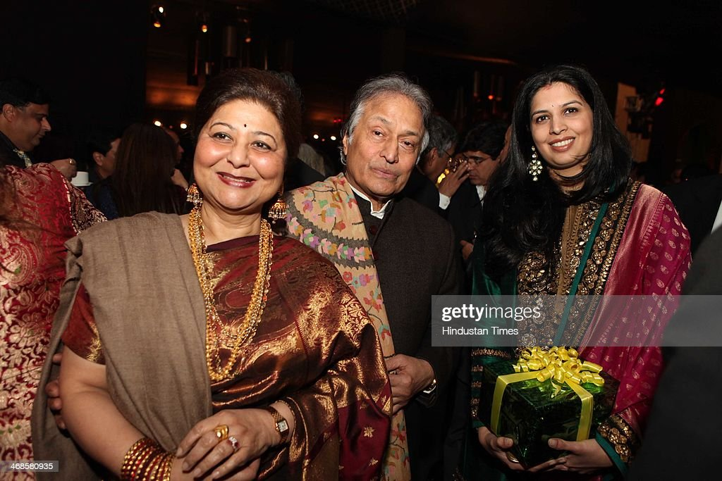 Ustaad Amjad Ali Khan with his wife Shubhalakshmi and daughter-in-law Neema during the wedding reception of Ahana Deol and Vaibhav Vohra on February 5, 2014 in New Delhi, India. Ahana, a budding Odissi dancer, is the daughter of Bollywood stars Dharmendra and Hema Malini while Vaibhav in an Indian businessman. They married on February 2, 2014 in Mumbai.