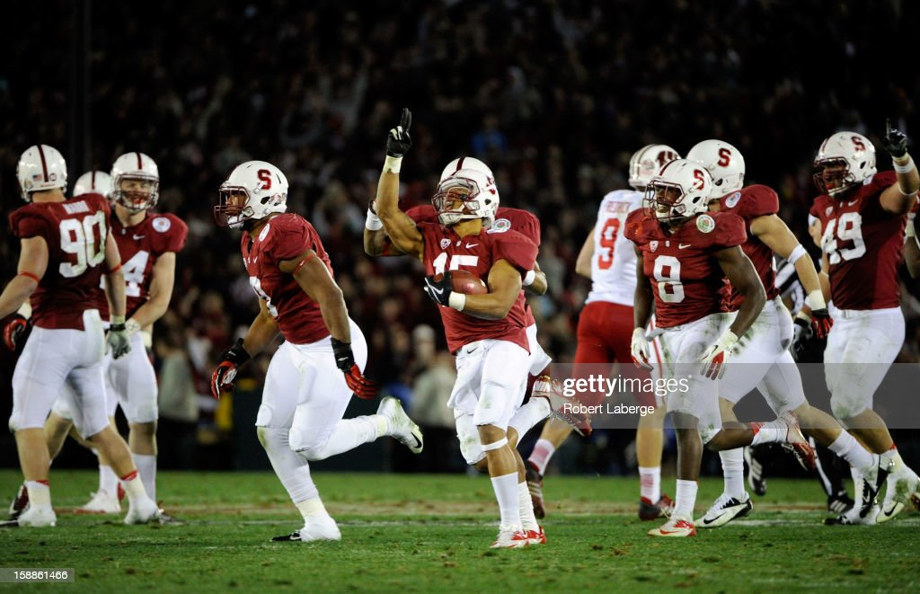Usua Amanam #15 of the Stanford Cardinal celebrates with teammates after making an interception in the fourth quarter against the Wisconsin Badgers in the 99th Rose Bowl Game Presented by Vizio on January 1, 2013 at the Rose Bowl in Pasadena, California.