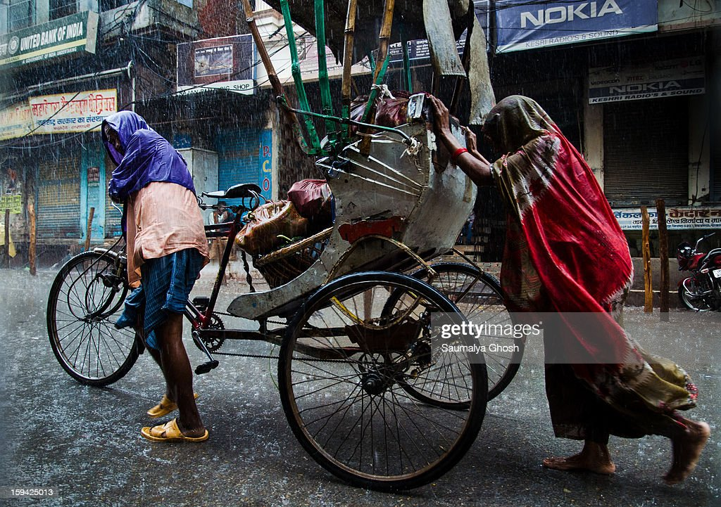 CONTENT] Usually Varanasi is a very busy city with narrow lanes and congested streets. However, due to incessant rainfall, the streets are merely deserted and the roadside shops are closed. But a rickshaw puller family is still busy with their day's work, in spite of the heavy downpour.