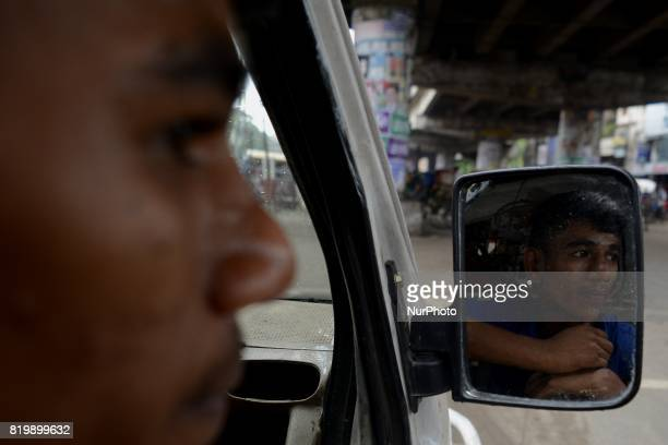 Usuf waiting for passengers on Thursday July 2017 in Dhaka Bangladesh As he is underaged he naturally doesn't have any driving license He has been...