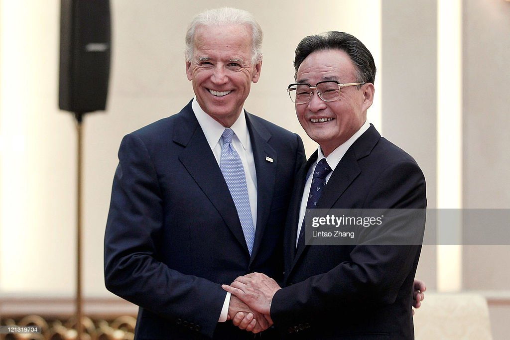 Vice President Joe Biden shakes hands with NPC Chairman Wu Bangguo inside the Great Hall of the People on August 18 2011 in Beijing China Biden will...
