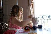 USA, Utah, American Fork, Girl (2-3) pouring tea in cup
