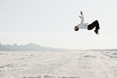 USA, Utah, Boneville Salt Flats, Young man doing backflip in desert