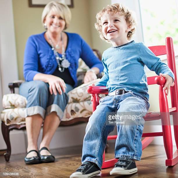 USA, Utah, Boy (2-3) playing with toy cart