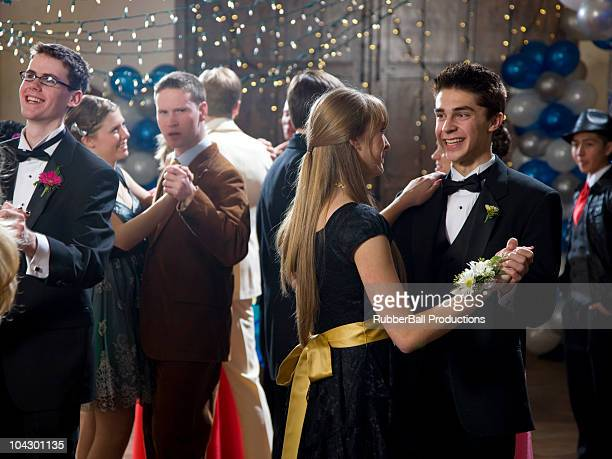 USA, Utah, Cedar Hills, Teenage couples (14-17) dancing at high school prom