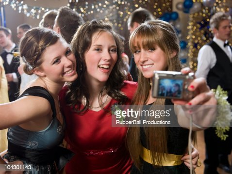 USA, Utah, Cedar Hills, Teenage girls (14-17) photographing themselves at high school prom