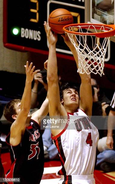 Utah center Andrew Bogut slams the ball home against San Diego State center Chris Manker Utah defeated San Diego State 7260 at the Jon Huntsman...