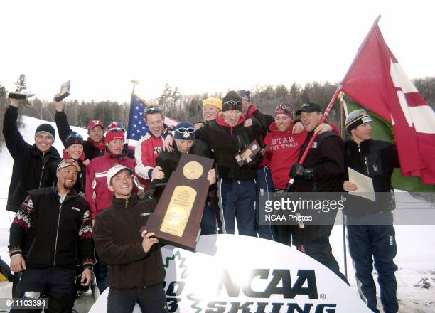 Utah coach Kevin Sweeney celebrates with his national championship team following the Division 1 Men's and Women's Skiing Championships held at the...