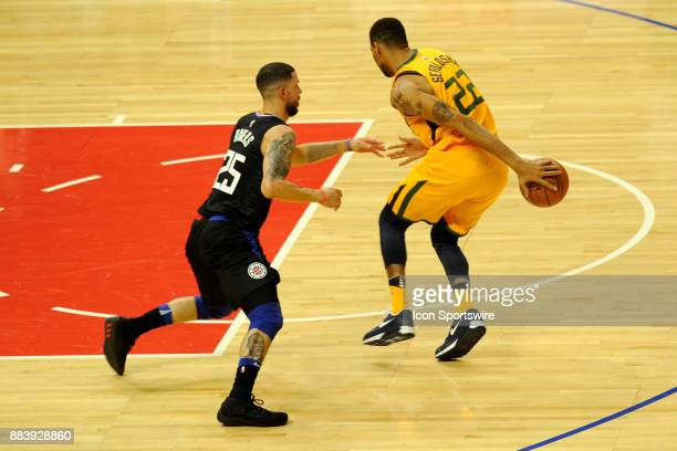 Utah F Thabo Sefolosha carries the ball under the defensive coverage of Clippers G Austin Rivers during the first half of their game on November 30...