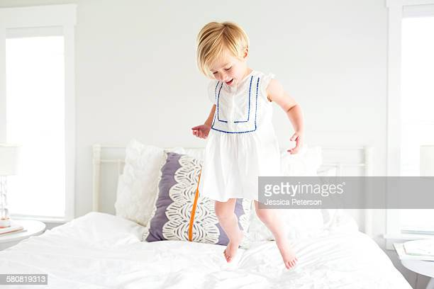 USA, Utah, Farmington, Girl (2-3) jumping on bed