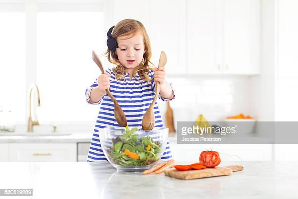 USA, Utah, Farmington, Girl (4-5) mixing salad