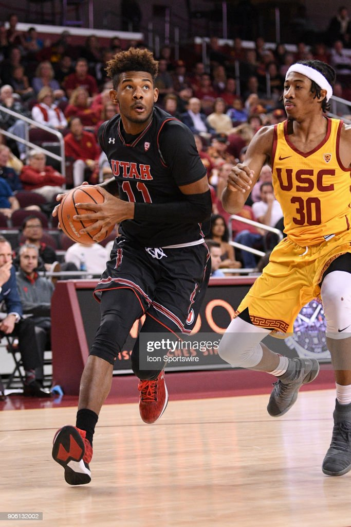 Utah forward Chris Seeley (11) drives to the basket as USC guard Elijah Stewart (30) defends during a college basketball game between the Utah Utes and the USC Trojans on January 14, 2018, at the Galen Center in Los Angeles, CA.
