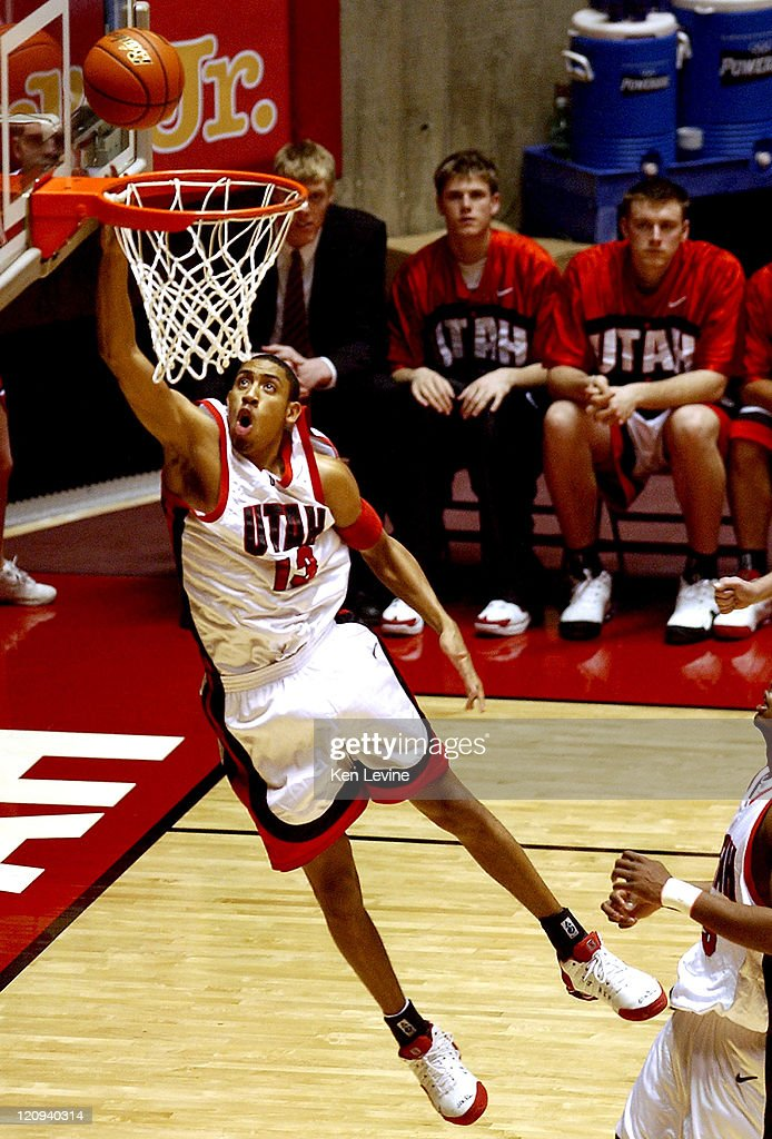 Utah forward Richard Chaney (13) scores on an uncontested layup. Utah defeated San Diego State 72-60 at the Jon Huntsman Center in Salt Lake City, Utah, on March 5, 2005.