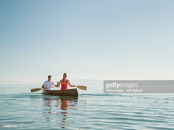 USA, Utah, Garden City, portrait of two young people paddling canoe