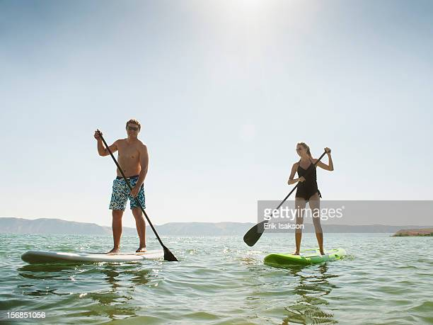 USA, Utah, Garden City, two people standing on paddleboard