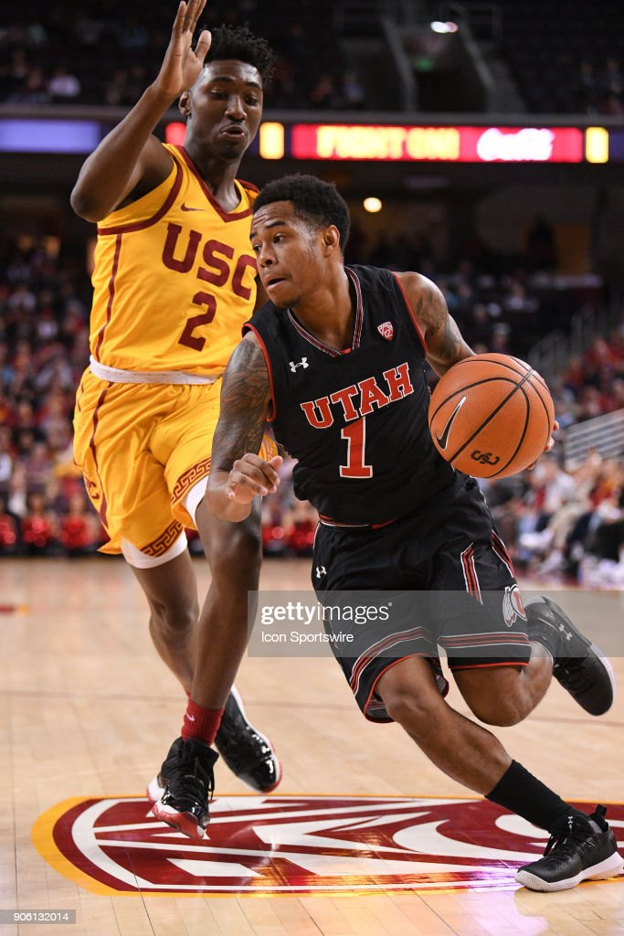 Utah guard Justin Bibbins (1) drives past USC guard Jonah Mathews (2) to the basket during a college basketball game between the Utah Utes and the USC Trojans on January 14, 2018, at the Galen Center in Los Angeles, CA.
