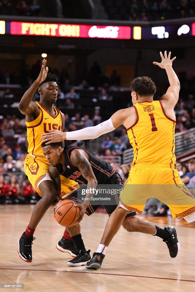 Utah guard Justin Bibbins (1) tries to split the double team of USC guard Jonah Mathews (2) and USC forward Jordan Usher (1) during a college basketball game between the Utah Utes and the USC Trojans on January 14, 2018, at the Galen Center in Los Angeles, CA.