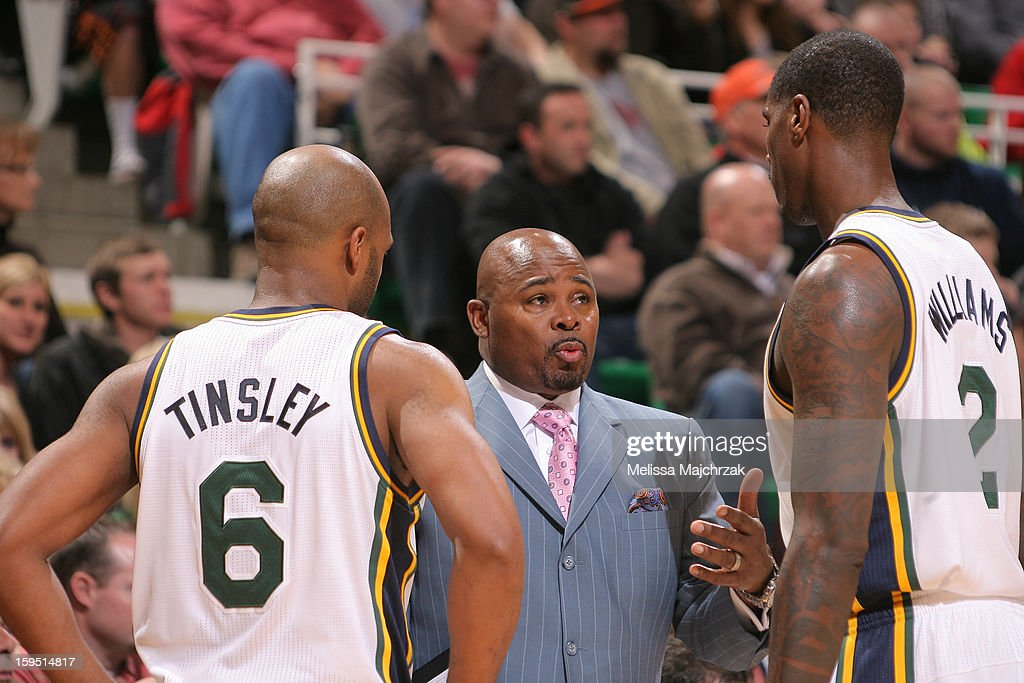 Utah Jazz Assistant Coach Sydney Lowe speaks with players Jamaal Tinsley #6 and Marvin Williams #2 during play against of the Miami Heat at Energy Solutions Arena on January 14, 2013 in Salt Lake City, Utah.