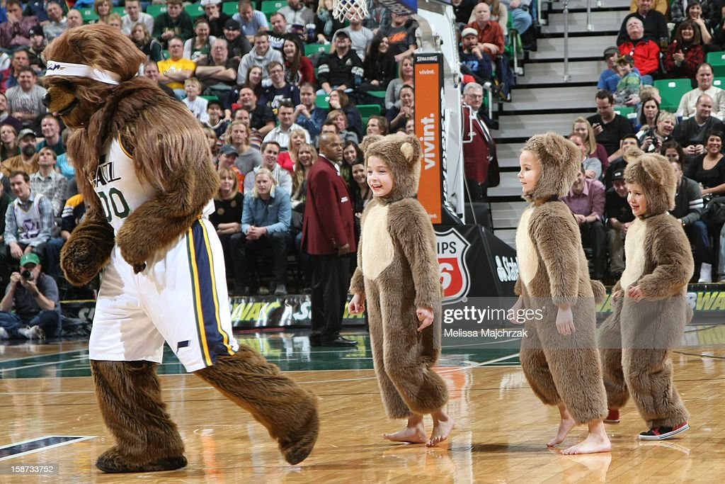 Utah Jazz Bear leads Jr. Bears in a game of Follow the Leader during a break in play against the Golden State Warriors at Energy Solutions Arena on December 26, 2012 in Salt Lake City, Utah.