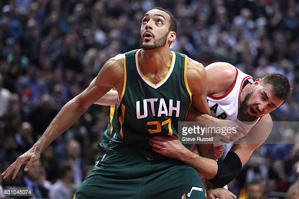 TORONTO ON JANUARY 5 Utah Jazz center Rudy Gobert and Toronto Raptors center Jonas Valanciunas battle under the basket as the Toronto Raptors beat...