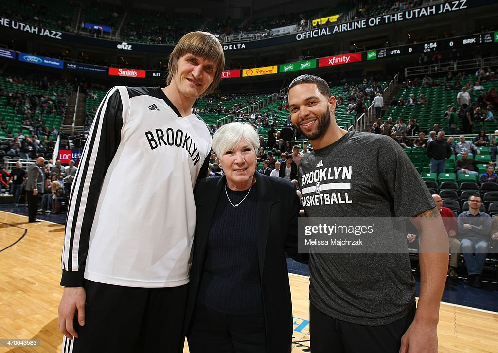 Utah Jazz owner Gail Miller poses with former Utah Jazz players <a gi-track='captionPersonalityLinkClicked' href=/galleries/search?phrase=Andrei+Kirilenko&family=editorial&specificpeople=201909 ng-click='$event.stopPropagation()'>Andrei Kirilenko</a> #47 and <a gi-track='captionPersonalityLinkClicked' href=/galleries/search?phrase=Deron+Williams&family=editorial&specificpeople=203215 ng-click='$event.stopPropagation()'>Deron Williams</a> #8, now of the Brooklyn Nets at EnergySolutions Arena on February 19, 2014 in Salt Lake City, Utah.