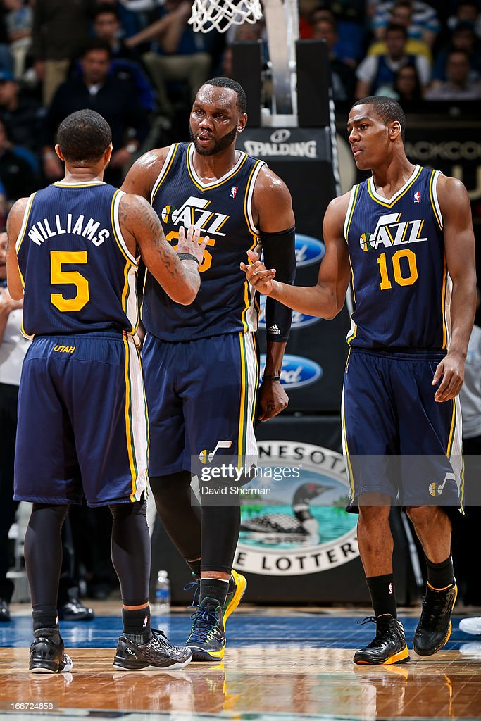 Utah Jazz players <a gi-track='captionPersonalityLinkClicked' href=/galleries/search?phrase=Al+Jefferson&family=editorial&specificpeople=201604 ng-click='$event.stopPropagation()'>Al Jefferson</a> #25, Mo Williams #5 and <a gi-track='captionPersonalityLinkClicked' href=/galleries/search?phrase=Alec+Burks&family=editorial&specificpeople=6834208 ng-click='$event.stopPropagation()'>Alec Burks</a> #10 speak during a game against the Minnesota Timberwolves on April 15, 2013 at Target Center in Minneapolis, Minnesota.