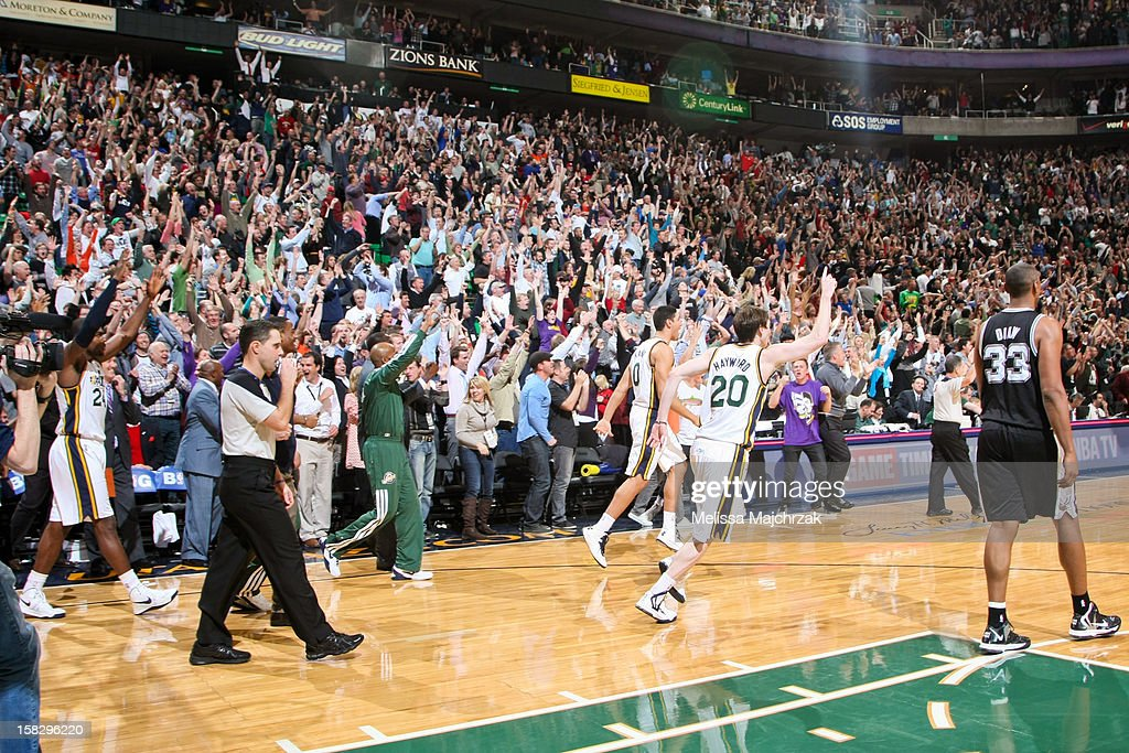 Utah Jazz players and fans celebrate the team's victory at the buzzer against the San Antonio Spurs at Energy Solutions Arena on December 12, 2012 in Salt Lake City, Utah.