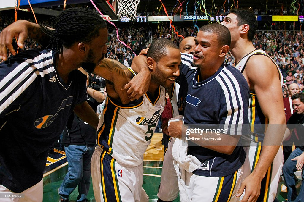 Utah Jazz players, from left, <a gi-track='captionPersonalityLinkClicked' href=/galleries/search?phrase=DeMarre+Carroll&family=editorial&specificpeople=784686 ng-click='$event.stopPropagation()'>DeMarre Carroll</a> #3, Mo Williams #5, <a gi-track='captionPersonalityLinkClicked' href=/galleries/search?phrase=Earl+Watson&family=editorial&specificpeople=201841 ng-click='$event.stopPropagation()'>Earl Watson</a> #11 and <a gi-track='captionPersonalityLinkClicked' href=/galleries/search?phrase=Enes+Kanter&family=editorial&specificpeople=5621416 ng-click='$event.stopPropagation()'>Enes Kanter</a> #0 celebrate a game-winning three-pointer by Williams at the buzzer against the San Antonio Spurs at Energy Solutions Arena on December 12, 2012 in Salt Lake City, Utah.