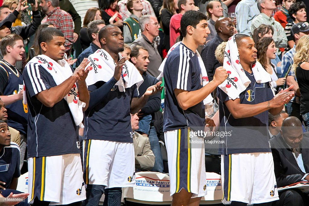 Utah Jazz players, from left, <a gi-track='captionPersonalityLinkClicked' href=/galleries/search?phrase=Earl+Watson&family=editorial&specificpeople=201841 ng-click='$event.stopPropagation()'>Earl Watson</a> #11, <a gi-track='captionPersonalityLinkClicked' href=/galleries/search?phrase=Paul+Millsap&family=editorial&specificpeople=880017 ng-click='$event.stopPropagation()'>Paul Millsap</a> #24, <a gi-track='captionPersonalityLinkClicked' href=/galleries/search?phrase=Enes+Kanter&family=editorial&specificpeople=5621416 ng-click='$event.stopPropagation()'>Enes Kanter</a> #0 and <a gi-track='captionPersonalityLinkClicked' href=/galleries/search?phrase=Randy+Foye&family=editorial&specificpeople=240185 ng-click='$event.stopPropagation()'>Randy Foye</a> #8 cheer their teammates on from the sideline against the Sacramento Kings at Energy Solutions Arena on November 23, 2012 in Salt Lake City, Utah.