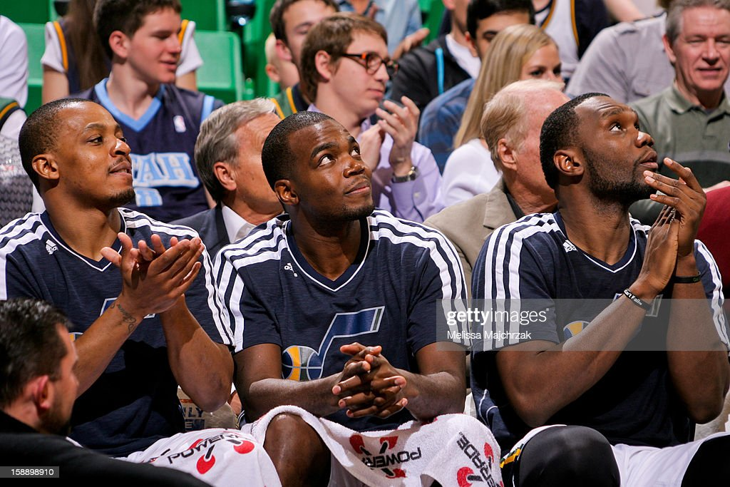 Utah Jazz players, from left, Randy Foye #8, Paul Millsap #24 and Al Jefferson #25 cheer on their teammates from the bench against the Minnesota Timberwolves at Energy Solutions Arena on January 2, 2013 in Salt Lake City, Utah.