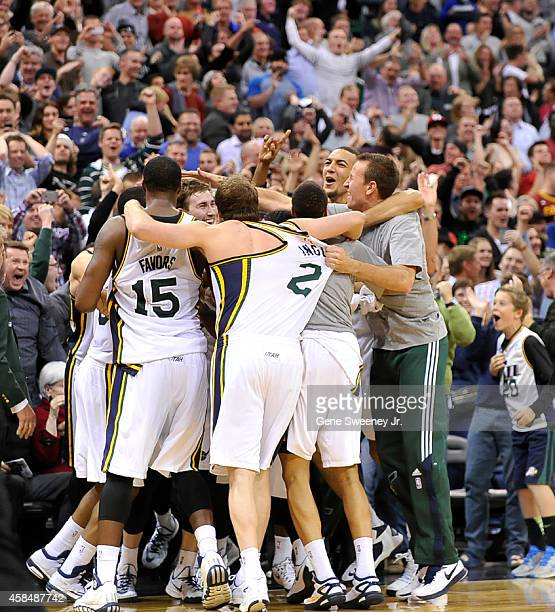 Utah Jazz players mob teammate Gordon Hayward after his buzzer shot beat the Cleveland Cavaliers at EnergySolutions Arena on November 5 2014 in Salt...