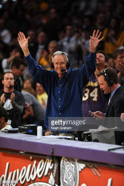Utah Jazz radio announcer Rod Hundley acknowledges the crowd's standing ovation after being recognized during Game Five of the Western Conference...
