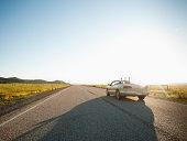 USA, Utah, Kanosh, Happy couple driving on empty road