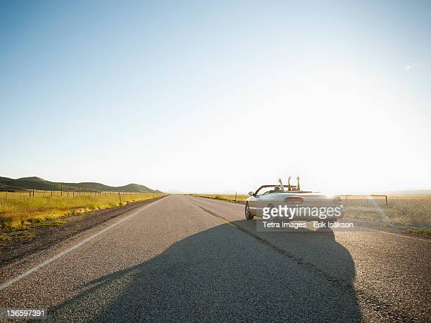 USA, Utah, Kanosh, Happy couple driving on empty road