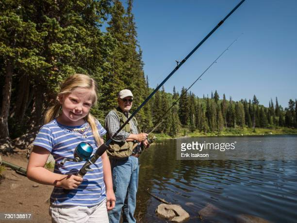 USA, Utah, Lake City, Girl (4-5) with grandfather fishing in lake