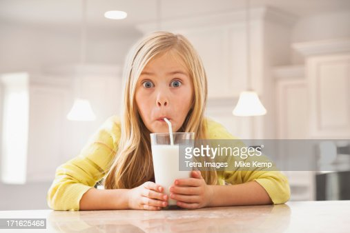 USA, Utah, Lehi, Blonde girl (6-7) drinking milk