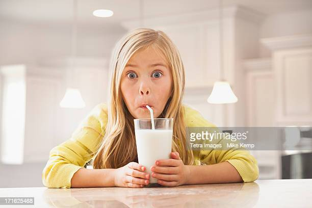 USA, Utah, Lehi, Blonde girl (6-7) drinking milk