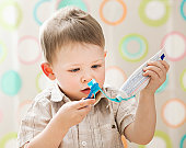 USA, Utah, Lehi, boy (2-3) brushing teeth