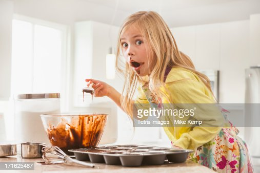 USA, Utah, Lehi, Girl (6-7) baking cupcakes : Stock Photo