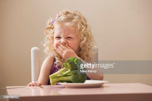 USA, Utah, Lehi, girl (2-3) disgusted with broccoli : Stock Photo