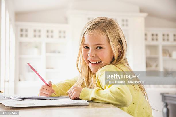 USA, Utah, Lehi, Girl (6-7) doing homework