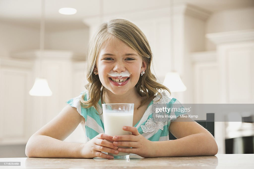 USA, Utah, Lehi, Girl (6-7) drinking milk
