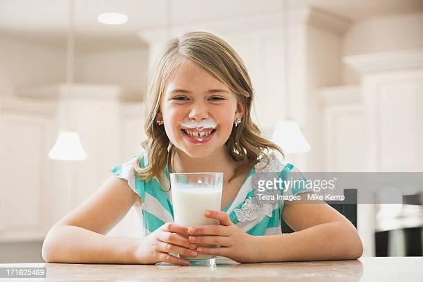 USA, Utah, Lehi, Girl (6-7) drinking milk