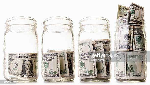 USA, Utah, Lehi, Glass jars filled with dollar bills