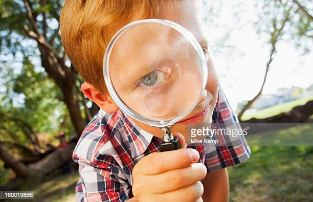 USA, Utah, Lehi, Little boy (6-7) looking through magnifying glass
