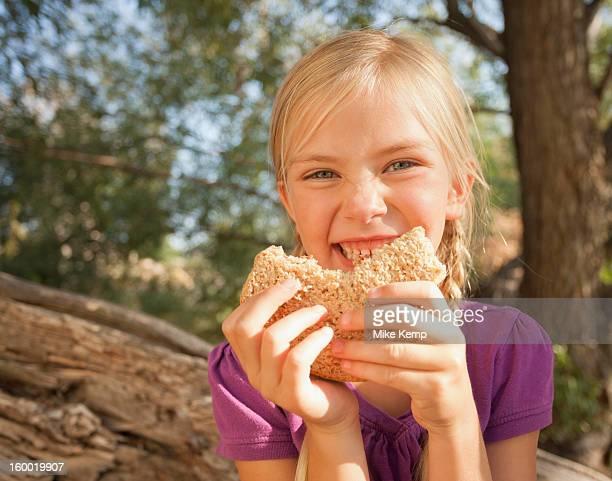 USA, Utah, Lehi, Little girl (4-5) eating peanut butter and jelly sandwich