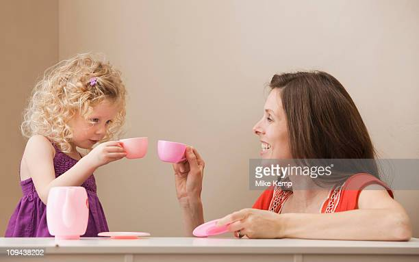 USA, Utah, Lehi, mother and daughter (2-30 having tea