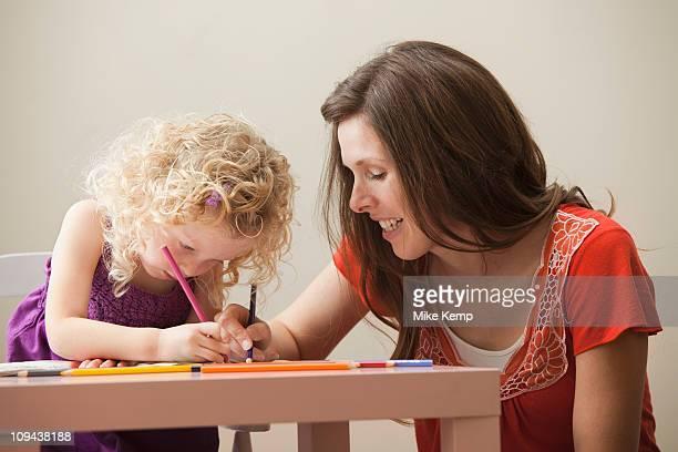 USA, Utah, Lehi, mother and daughter (2-3) drawing together
