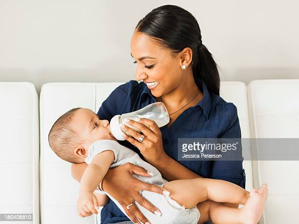 USA, Utah, Lehi, Mother feeding baby (2-5 moths)