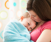 USA, Utah, Lehi, mother with son (2-3) wrapped in towel